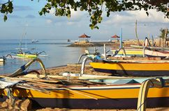 Bali Outrigger Fishing Boats on Sanur beach, Indonesia at dawn. Royalty Free Stock Images