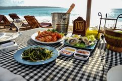 Seafood on the beach Jimbaran on Bali stock photos