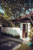 Bali resort house under frangipani tree Stock Image