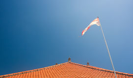 Bali's roof. And national flag Stock Images