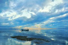 Bali Sanur Beach. Bali famous Sanur Beach with a rolling boat royalty free stock image