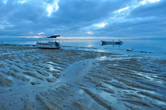 Bali Sanur Beach at dawn. Bali Sanur Beach witn boats at dawn royalty free stock image