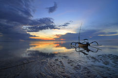 Bali Sanur Beach at dawn. With a lonely boat royalty free stock photography