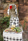 Bali Statue With Food Offerings Royalty Free Stock Images