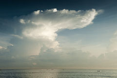 Bali Storm Cloud. A huge thundercloud looms over this Indian Ocean tropical paradise off the coast of Bali Stock Image
