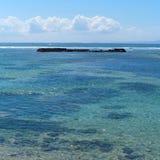 Bali strand med sikt på havet Arkivfoto
