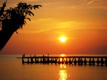 Bali sunrise over the golden ocean and jetty Royalty Free Stock Photo