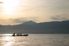 Bali sunrise @ sea. A small balinese fisherboat at the coast of Lovina, while the sun rises stock image