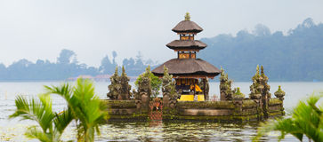 Bali Temple. Panorama of beautiful Bali water temple at Bratan lake Royalty Free Stock Photo