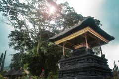 Bali Temple amid green lush tree and tropical forest. At a cloudy noon day stock images