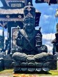 Bali temple statue. Lawa stone statue. Blue sky stock photos