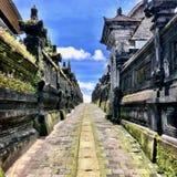 Bali temple road. Bali temple statue. Lawa stone statue. Blue sky stock photography