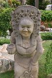 Statue Balinese or Siamese old woman in the garden. Stock Images