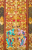 Bali wood carving. Ancient wood carving with paint at the inner part of Ulan Danu temple in Bali royalty free stock photography
