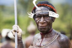 Dani tribesman at the annual Baliem Valley Festival. Baliem Valley, West Papua/Indonesia - August 9, 2016: Portrait of a Dani tribesman at the annual Baliem stock images