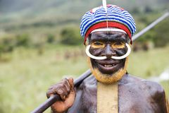 Dani tribesman at the annual Baliem Valley Festival. Baliem Valley, West Papua/Indonesia - August 9, 2016: Portrait of a Dani tribesman at the annual Baliem royalty free stock photo