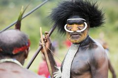 Dani tribesmen at the annual Baliem Valley Festival. Baliem Valley, West Papua/Indonesia - August 9, 2016: Portrait of a Dani tribesmen at the annual Baliem stock photo
