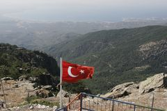 Turkish flag with mount Ida in autumn, Turkey. BALIKESIR, TURKEY- August ,28 2005 : The place where is located the tomb of sarikiz and today is Sarikiz Hill stock images