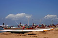 Balinese Boats. Colorful Balinese boats on the beach at Tanjung Benoa, Bali royalty free stock photos