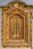 Balinese carving window in Batuan temple, Bali Stock Images