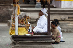 Balinese ceremony in the temple. TAMPAK SIRING, BALI, INDONESIA - SEP 21: People praying at holy spring water temple Puru Tirtha Empul during the religious stock images