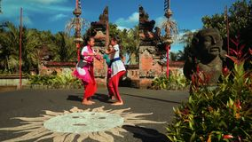 Balinese dance performance by three woman on beautiful stage, editorial