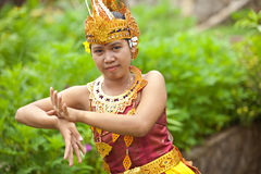 Balinese dancer. Young Balinese female dancer performing traditional Legong dance Stock Photos