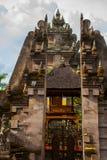 Balinese entrance gate of the temple. Ubud, Bali, Indonesia. Beautiful Balinese entrance gate of the temple, a Hindu temple in the center of Ubud, Bali Stock Photo