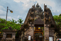 Balinese entrance gate of the temple. Ubud, Bali, Indonesia. Royalty Free Stock Image