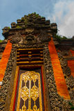 Balinese entrance gate of the temple. Ubud, Bali, Indonesia. Beautiful Balinese entrance gate of the temple, a Hindu temple in the center of Ubud, Bali Royalty Free Stock Images