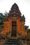 Balinese entrance gate of the temple. Ubud, Bali, Indonesia. Beautiful Balinese entrance gate of the temple, a Hindu temple in the center of Ubud, Bali Stock Photography