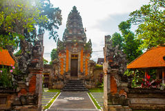 Balinese entrance gate of the temple. Ubud, Bali, Indonesia. Beautiful Balinese entrance gate of the temple, a Hindu temple in the center of Ubud, Bali Royalty Free Stock Image