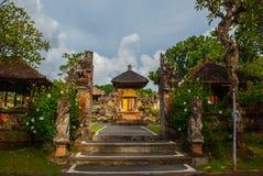 Balinese entrance gate of the temple. Ubud, Bali, Indonesia. Beautiful Balinese entrance gate of the temple, a Hindu temple in the center of Ubud, Bali Royalty Free Stock Photo