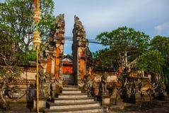 Balinese entrance gate of the temple. Ubud, Bali, Indonesia. Beautiful Balinese entrance gate of the temple, a Hindu temple in the center of Ubud, Bali Stock Images
