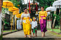 Balinese family in traditional clothes during the celebration be stock image