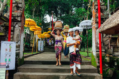 Balinese family in traditional clothes Royalty Free Stock Photo