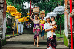 Balinese family in traditional clothes Royalty Free Stock Image