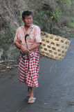 Balinese farmer on the road Royalty Free Stock Photos
