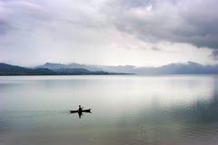 Balinese fisherman.  Batur lake Stock Photos