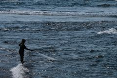 A Balinese fisherman pulling in his net royalty free stock photography