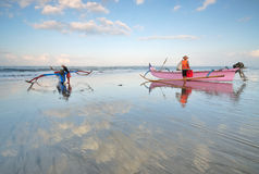 Balinese fishermen at a beach Royalty Free Stock Image