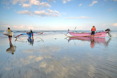 Balinese fishermen were preparing their boats before heading for the sea Stock Photography