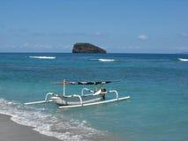 Balinese fishing boat. Traditional Balinese fishing boat, Jukung, at Candidasa in Bali Royalty Free Stock Photos