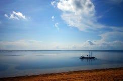 Balinese fishing boat on sea stock photography