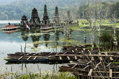 Balinese flooded temple. Hindu flooded temple in Tumblingan. Reflections and pirogues Stock Image