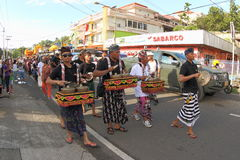 Balinese Gamelan at Cultural Festival 2017. Balinese men on a parade playing percussive instruments called Gamelan. It`s  traditional ensemble music of Java and Royalty Free Stock Photos