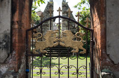 Balinese gate. With golden lion stock photography