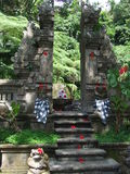 Balinese Gateway. Carved stone gate at entrance to a sacred spring Stock Photos