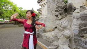 Balinese girl dancing traditional dance in uluwatu temple, bali stock footage