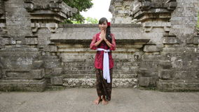 Balinese girl dancing traditional dance in uluwatu temple, bali Royalty Free Stock Photo